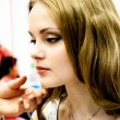 Stock Photo: Makeup artist bring girl make-up