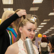 Girl in a beauty salon doing hairdo. — Stock Photo