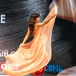Girl with scarf dances on catwalk. — Stock Photo #29551613