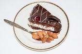 A piece of sweet dessert and almonds — Foto de Stock