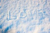Happy Valentine's Day. The inscription on the snow — Stockfoto