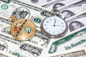 Pocket watches and money — Stock Photo