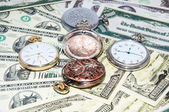 Pocket watches and money — 图库照片