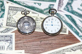 Pocket watches and money. — Stock Photo