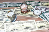 Pocket watches and money. — Foto de Stock