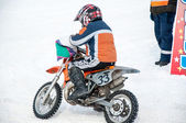 Winter cross-country motorcycle race competitions of children — Photo