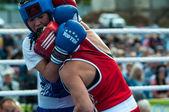 Public performance of girls boxing — Stock Photo