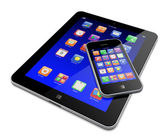Tablet PC with mobile phone — Stock Photo