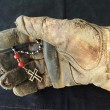 Stock Photo: Leather Work Glove Holding AnglicPrayer Beads