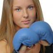 Young blonde woman with boxing gloves — Stock Photo