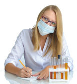 Young beautiful female doctor with recipe and mask — Stock Photo