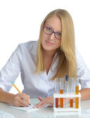Young beautiful female doctor with recipe — Stock Photo