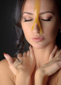 Beautiful woman with honey mask — Stok fotoğraf