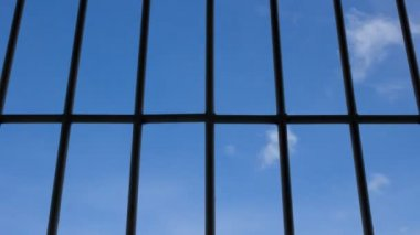 Prison bars and blue sky — Stock Video