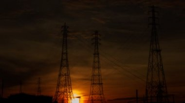 Electric pylons with time lapse sunrise — Stock Video