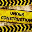 Rusty under construction sign — Stock Photo #13914180