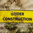 Under construction broken sign — Stock Photo
