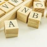 Wood alphabet cube — Stock Photo #13915588