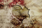 Old and fracture wall with carved heart — Stock Photo