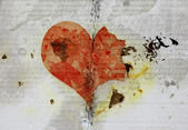 Burned and tear heart on paper background — Stock Photo