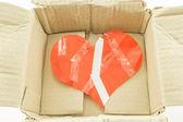 Bad heart inside damage box — Stock Photo