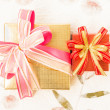 Giftbox big and small on mulberry paper — Stock Photo #16495093