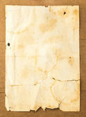 Old paper background on wood — Stock Photo