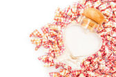 Paper heart background and glass bottle — Stock Photo