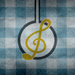 Music symbol on dirty seamless plaid — Stock Photo