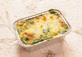 Bake spinach with cheese — Stock Photo