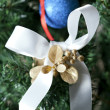 Christmas bow on a tree — Stock Photo