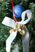 Christmas bow on a tree — Stok fotoğraf