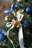 Christmas boy on a tree — Stock Photo