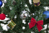 Christmas toys on a tree — Stockfoto