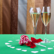 Stock Photo: Two glases of champagne next to heart shape candy