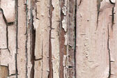 Vintage texture of a red piece of wood — Stock Photo