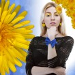 Beautiful blonde with daisy in hair - Foto Stock