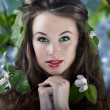 Gorgeous girl with flowers in hair, proffesional make up — Stock Photo