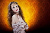 Sensual girl on vintage artistic background — Stock Photo