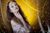 Beautiful glamour girl on artistic background — Stock Photo