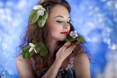 Sensual girl on abstract background from flowers. Glamour make u — Stock Photo