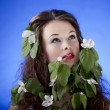 Stock Photo: Beautiful girl with flowers. Professional make up, glamour skin,