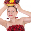 Beautiful woman with a plate of fruits in had and cherries on br — Stock Photo