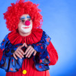 Clown on blue backgound — Stock Photo #29116527