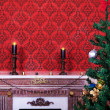 Sensasional vintage Christmas interior with two candles on a red — Stock Photo