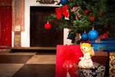 Christmas angel with a fireplace on background — Stok fotoğraf