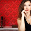 Sensual glamour girl on red vintage background — Stock Photo