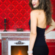 Sensual woman next to a fireplace in vintage room — Stock Photo #30369967
