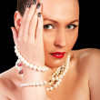 Fashion glamour portrait of a woman wearing luxury pearls — Stock Photo