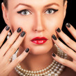Fashion glamour portrait of a beautiful woman with art nails on  — Stock Photo